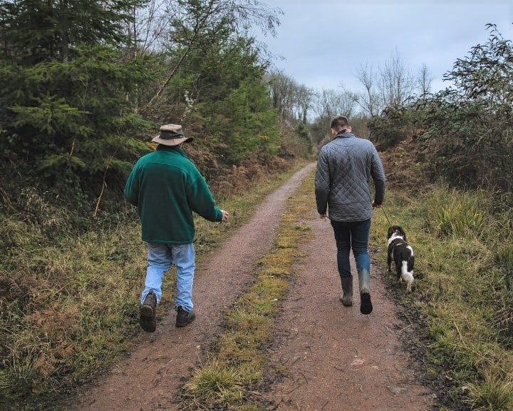 Two Guys and One Dog Walking