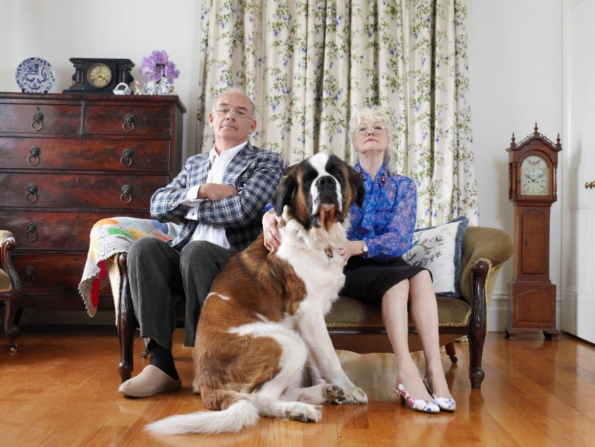 Elderly couple with their big dog